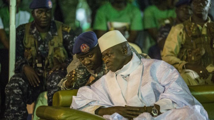 File:  Gambian President Yahya Jammeh listening to one of his aides in Banjul in November 2016 (AFP)