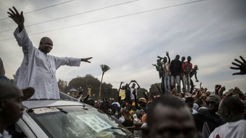 File: Adama Barrow celebrates his election victory with his supporters