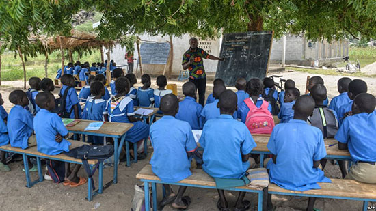 FILE - A teacher conducts his class under a tree in Moho, a village in the Northern Province of Cameroon, Sept. 16, 2016.