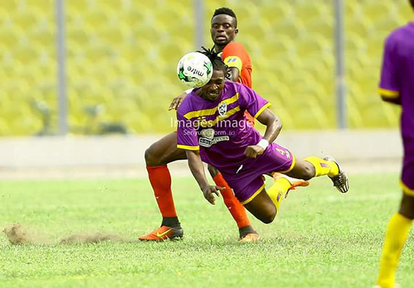 A Medeama player and a Hearts of Oak player fight for the ball in their week 2 Ghana Premier League match played at the Accra Sports Stadium on 02/1917. Photo - S. A. Adadevoh