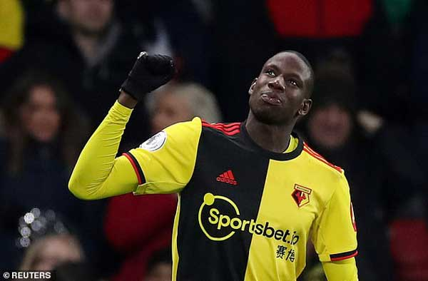 Abdoulaye Doucoure celebrate his deflected shot off Conor Coady that gave Watford a 2-0 lead over Wolves.