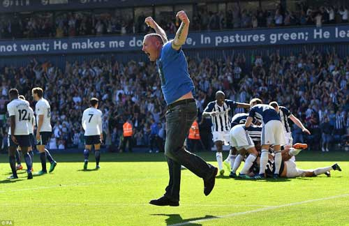 A pitch invader cannot hide his delight as he runs on the pitch to celebrate West Brom's winner.