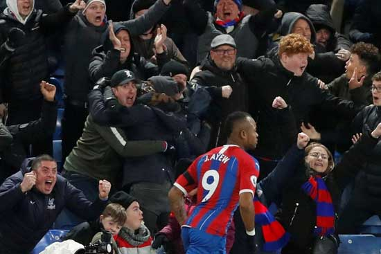 Jordan Ayew and Crystal Palace fans celebrate his spectacular 90th minute winner against West Ham.