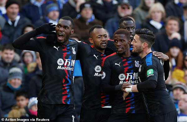 Jordan Ayew (second from left) celebrates his winning goal with teammates