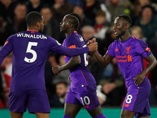 Liverpool's Naby Keïta (8) celebrates scoring the equalizer with teammates Sadio Mane and Wijnaldum. Reuters photo