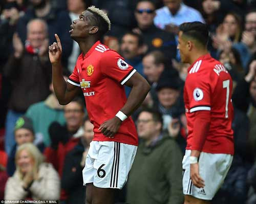 Paul Pogba celebrates with Alexis Sanchez after giving Manchester United the lead with his close-range effort on Sunday.
