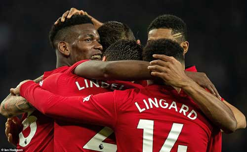 Paul Pogba celebrates his second in United's 3-1 win over Huddersfield with teammates.