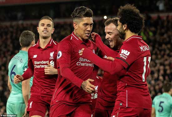 Roberto Firmino is surrounded by Jordan Henderson (left), Xherdan Shaqiri (second right) and Salah after putting Liverpool 5-1 up.