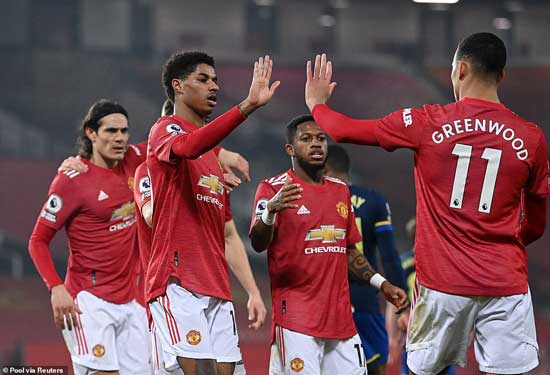 Manchester United players celebrate putting nine goals past Southampton, who were reduced to nine men throughout the course of the match.