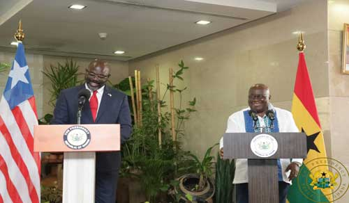 Liberian President, George M. Weah (L) and Ghana's President, Nana Akufo-Addo during the press conference at the Jubilee House.