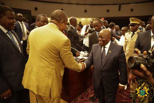 President Akufo-Addo (R) shakes hands with a member of the Togolese delegation (back to camera).