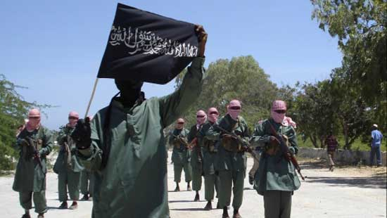File image - Al-Shabab fighters march on the outskirts of Mogadishu.