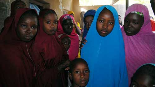 Aishat Alhaji, second from right, one of the girls abducted in February from a boarding school, is photographed after her release, in Dapchi, Nigeria, March 21, 2018.