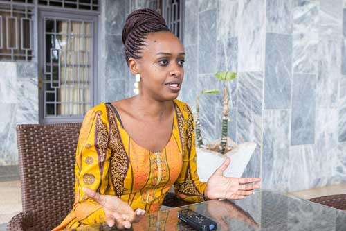 Diane Rwigara, a critic of veteran Rwandan President Paul Kagame, gestures during an interview with Reuters in Kigali, Rwanda January 26, 2019. REUTERS/Jean Bizimana