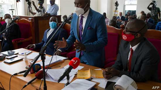 Merdad Segona, center, lawyer for former Ugandan presidential candidate Robert Kyagulanyi, aka Bobi Wine, speaks during a civil court hearing in Kampala, Jan. 21, 2021, to seek an end to house arrest for Kyagulanyi and his wife.