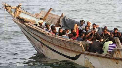 African illegal immigrants sit on a boat in the southern port city of Aden on September 26, 2016, before being deported to Somalia. Photo credit: AFP