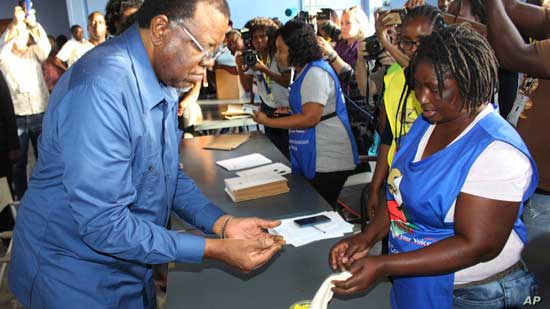 Namibian President Hage Geingob casts his ballot in Windhoek, Namibia in the country's elections, Nov. 27, 2019.