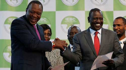 Uhuru Kenyatta, left, reacts after he was announced winner of the presidential election. Photo - CBC