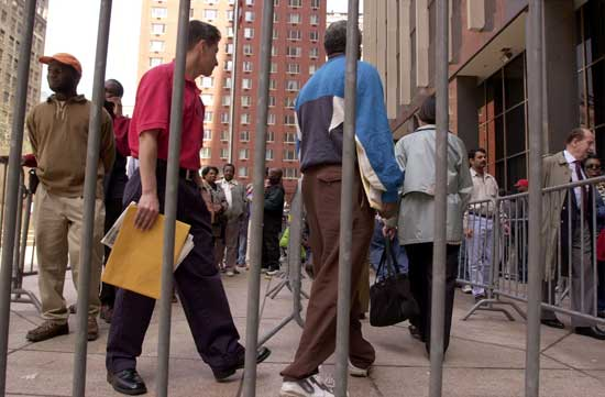 Hundreds of illegal immigrants line up in New York in 2001 to apply for green cards before having to leave the country.Spencer Platt / Getty Images file