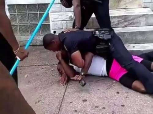 A Baltimore police officer was suspended on Saturday, Aug. 11, 2018, after he was seen on video repeatedly punching a man who refused to show identification.
