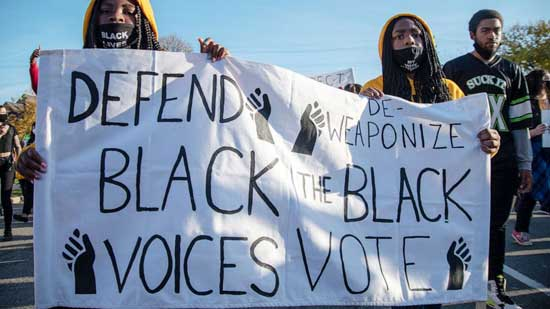 Activists from 12 local organizations marched through the city to call for the protection of Detroits votes over concerns of Donald Trumps claims that Democrats stole the election in Detroit, Nov. 7, 2020.
