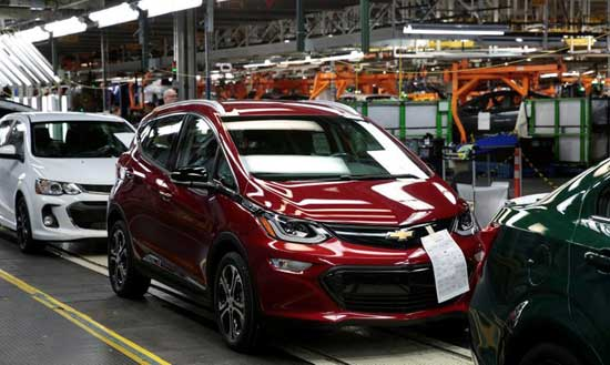 FILE PHOTO: A red 2018 Chevrolet Bolt EV vehicle is seen on the assembly line at General Motors Orion Assembly in Lake Orion, Michigan, U.S., March 19, 2018. REUTERS/Rebecca Cook
