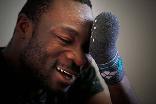Seidu Mohammed walked across the United States border into Manitoba and lost all his fingers to frostbite. He has now won the right to stay in Canada. (John Woods/THE CANADIAN PRESS)