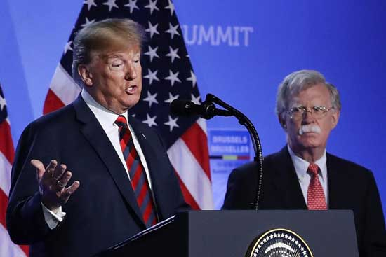 US President Donald Trump (R) fires foreign policy hawk Bolton, citing strong disagreements. File image