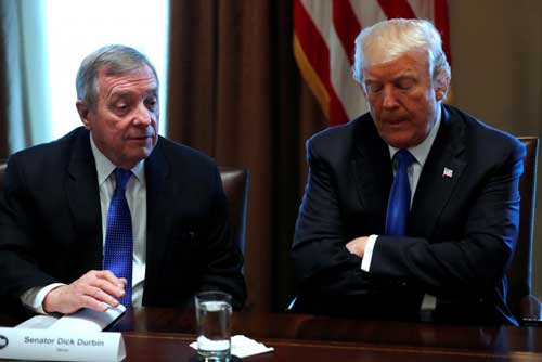File photo - U.S. President Donald Trump, flanked by U.S. Senator Dick Durbin (D-IL), holds a bipartisan meeting with legislators on immigration reform at the White House in Washington, U.S. January 9, 2018. REUTERS/Jonathan Ernst