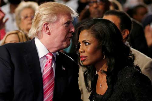 Republican presidential nominee Donald Trump and Omarosa Manigault attend a church service, in Detroit, Michigan, U.S., September 3 2016. REUTERS/Carlo Allegri/File Photo