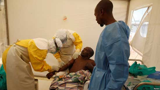 Medical staff and an Ebola survivor treat Ebola patient Ibrahim Mupalalo inside the Biosecure Emergency Care Unit at The Alliance for International Medical Action Ebola treatment center in Beni, Democratic Republic of Congo, March 31, 2019.