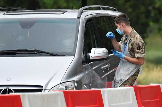 Military personnel are seen at a drive-through coronavirus disease (COVID-19) testing facility in Hyde Park, following the outbreak of the coronavirus disease, London, Britain, June 11, 2020.  File image