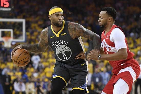 Golden State Warriors center DeMarcus Cousins (0) controls the ball as Toronto Raptors forward Norman Powell defends during the first half of Game 4 of basketball's NBA Finals, Friday, June 7, 2019, in Oakland, Calif. (Frank Gunn/The Canadian Press via AP)