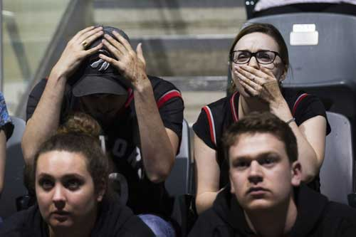Toronto Raptors fans react during the last seconds of Game 5 of the NBA Final between the Toronto Raptors and Golden State Warriors on a big screen inside the Leon's Centre in Kingston, Ontario, on Monday June 10, 2019. (Lars Hagberg/The Canadian Press via AP