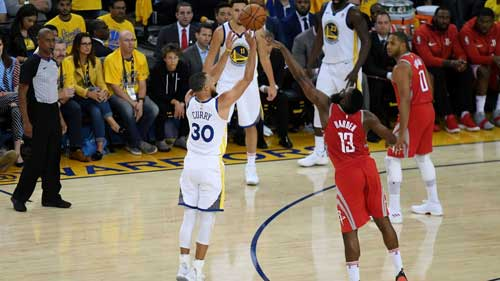 Stephen Curry drains a three against James Harden during Game 3. (Thearon W. Henderson / Getty Images)