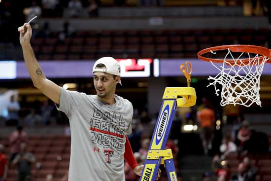 Texas Tech guard Davide Moretti holds up a piece of the net after the team's win over Gonzaga in the West Regional final in the NCAA men's college basketball tournament Saturday, March 30, 2019, in Anaheim, Calif. Texas Tech won 75-69. (AP Photo/Marcio Jose Sanchez)