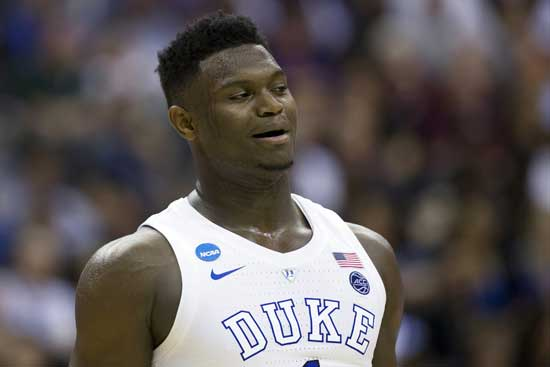 In this March 29, 2019, file photo, Duke forward Zion Williamson (1) reacts during an East Regional semifinal in the NCAA men's basketball tournamenet against Virginia Tech in Washington. (AP Photo/Alex Brandon, File)