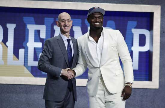 Duke's Zion Williamson, right, poses for photographs with NBA Commissioner Adam Silver after being selected by the New Orleans Pelicans as the first pick during the NBA basketball draft Thursday, June 20, 2019, in New York. (AP Photo/Julio Cortez)