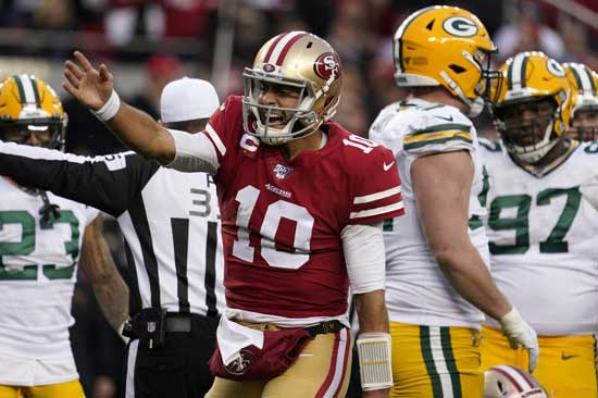San Francisco 49ers quarterback Jimmy Garoppolo (10) celebrates after converting a first down against the Green Bay Packers during the first half of the NFL NFC Championship football game Sunday, Jan. 19, 2020, in Santa Clara, Calif. (AP Photo/Tony Avelar)