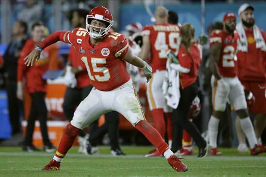 Kansas City Chiefs' quarterback Patrick Mahomes celebrates his touchdown pass to Damien Williams in the the second half of the NFL Super Bowl 54 football game Sunday, Feb. 2, 2020, in Miami Gardens, Fla. (AP Photo/John Bazemore)