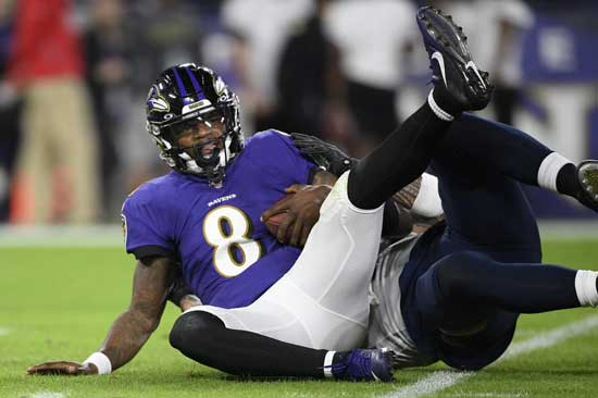Baltimore Ravens quarterback Lamar Jackson (8) is sacked by Tennessee Titans outside linebacker Kamalei Correa (44) during the first half an NFL divisional playoff football game, Saturday, Jan. 11, 2020, in Baltimore. (AP Photo/Nick Wass)