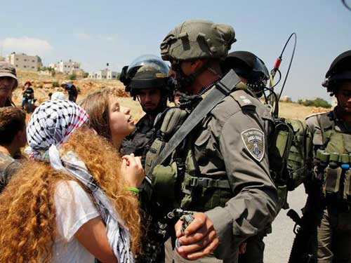 Israel arrests Palestinian girl Ahed Tamimi over viral video of soldier slapping.