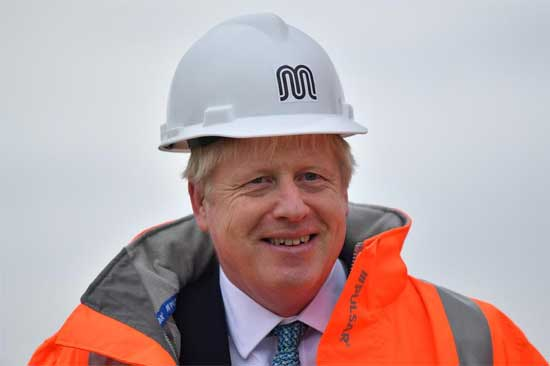 Britain's Prime Minister Boris Johnson reacts as he meets engineering graduates on the site of an under-construction tramline in Stretford, near Manchester, Britain July 27, 2019. Ben Stansall/Pool via REUTERS