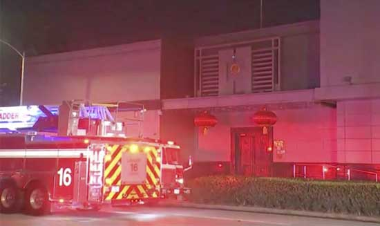 In this image made from video, fire engine is seen outside Chinese consulate in Houston, Tuesday, July 21, 2020. Media reports in Houston said that authorities had responded to reports of a fire at the consulate. Witnesses said that people were burning paper in what appeared to be trash cans, the Houston Chronicle reported, citing police.(KTRK via AP)