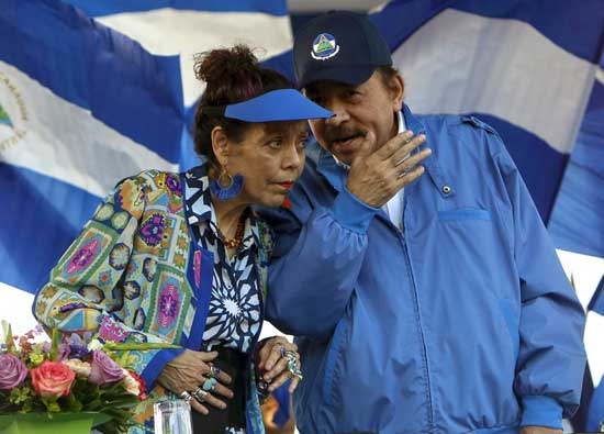 In this Sept. 5, 2018 file photo, Nicaragua's President Daniel Ortega and his wife and Vice President Rosario Murillo, lead a rally in Managua, Nicaragua. The Central American country has created a National Ministry for Extraterrestrial Space Affairs, The Moon and Other Celestial Bodies. The new agency was approved on Wednesday, Feb. 17, 2021, by 76 legislators in the country's congress, which is dominated by President Daniel Ortega's Sandinista Party. (AP Photo/Alfredo Zuniga, File)