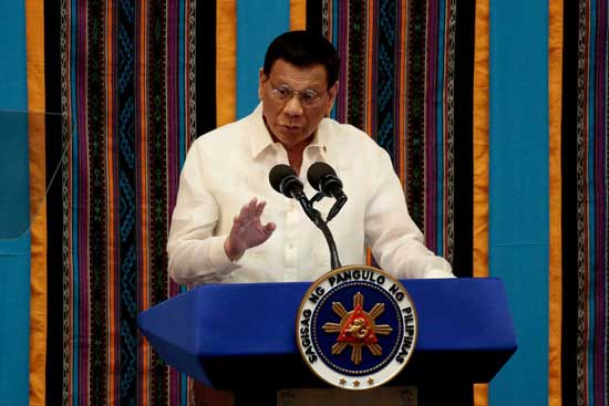 Philippine President Rodrigo Duterte gestures during his fourth State of the Nation address at the Philippine Congress in Quezon City, Metro Manila, Philippines, July 22, 2019. REUTERS/Eloisa Lopez/File Photo/File Photo
