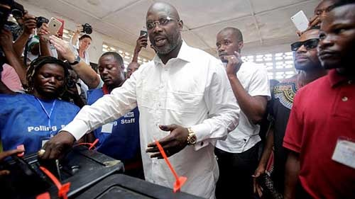 Ex-football star George Weah ahead in Liberia election.