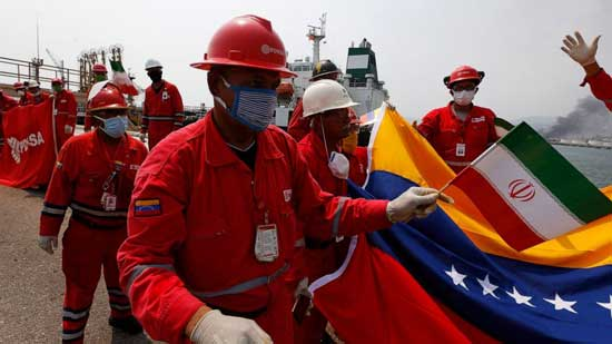 A Venezuelan oil worker holding a small Iranian flag attends a ceremony for the arrival of Iranian oil tanker Fortune at the El Palito refinery near Puerto Cabello, Venezuela, Monday, May 25, 2020.  File image
