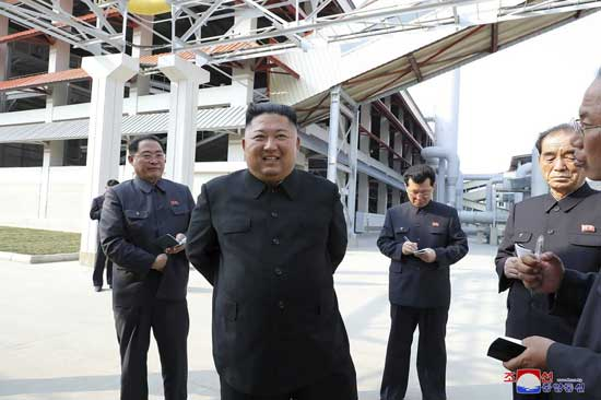 In this Friday, May 1, 2020, photo provided by the North Korean government, North Korean leader Kim Jong Un, center, visits a fertilizer factory in Sunchon, South Pyongan province, near Pyongyang, North Korea. Kim made his first public appearance in 20 days as he celebrated the completion of the fertilizer factory. AP Photo