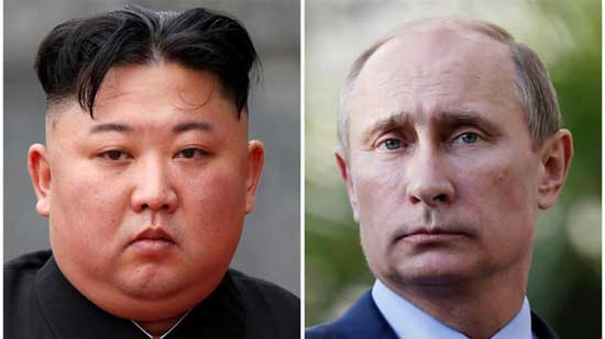 A combination of file photos shows North Korean leader Kim Jong Un attending a wreath laying ceremony at Ho Chi Minh Mausoleum in Hanoi, Vietnam March 2, 2019 and Russia's President Vladimir Putin looking on during a joint news conference with South African President Jacob Zuma after their meeting at the Bocharov Ruchei residence in the Black Sea resort of Sochi, Krasnodar region, Russia, May 16, 2013. REUTERS/Jorge Silva/Pool/Maxim Shipenkov/Pool